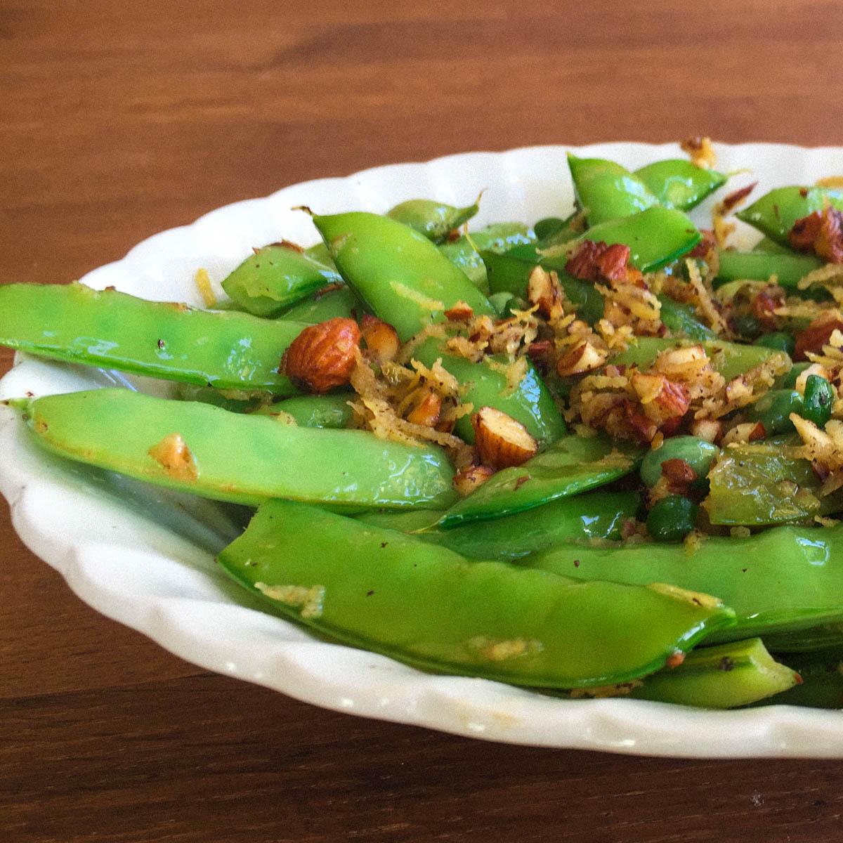 Recepten met peultjes: met geroosterde amandelen en citroenschil